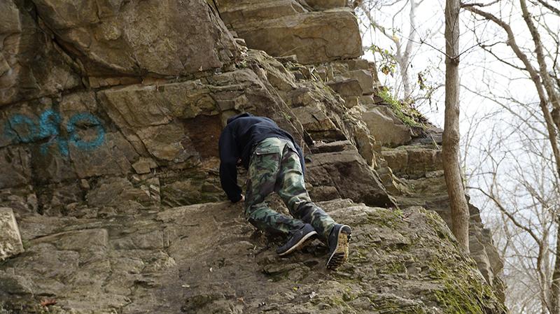Arthur climbing rocks