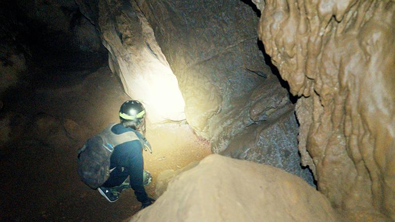 Arthur exploring a cave