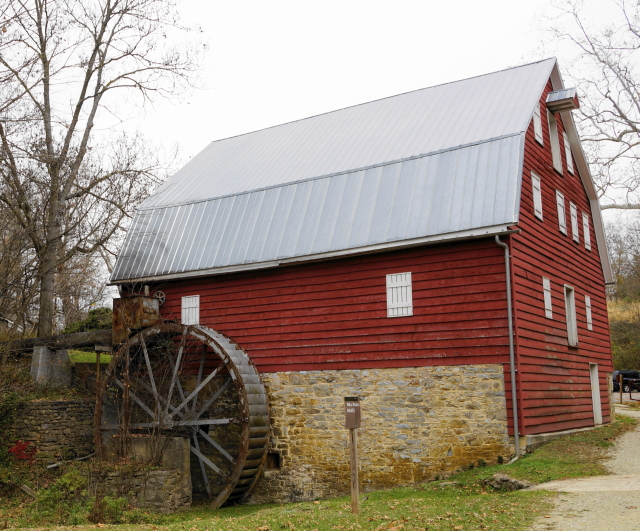 Stone and red wood mill.