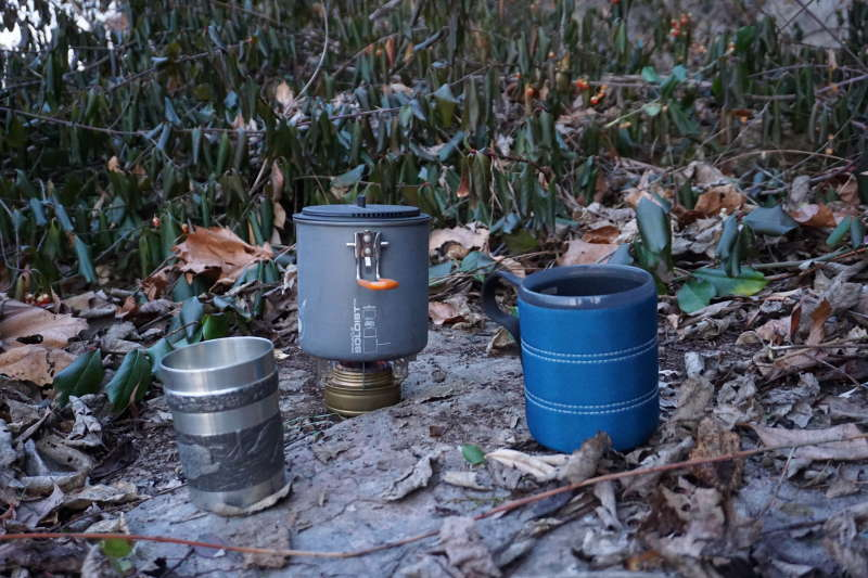 Two cups and the camp stove for making tea. This is on the shelf of rock called Arthur's Rock near McMahon's Mill.